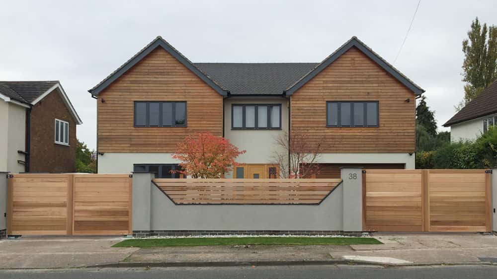 Double Entrance with Wooden Driveway Gates