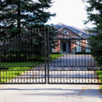 Metal Gate with house view