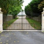 Metal gate at the end of driveway